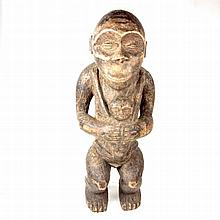 Tribal Art: A standing figure with child, probably from Borneo. 19.8 in (50
