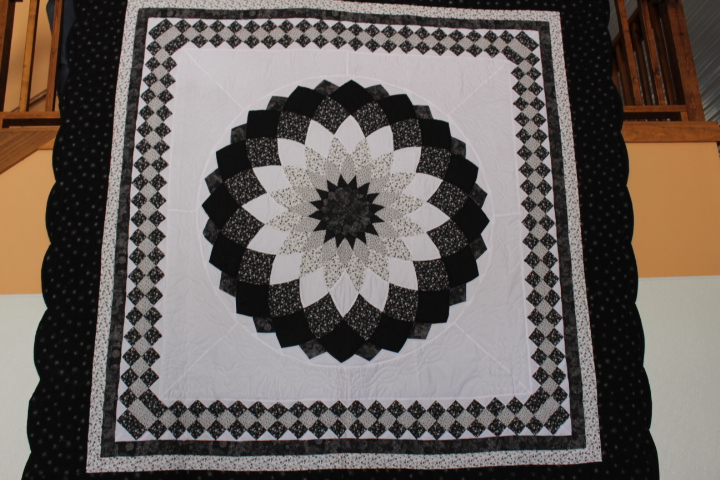 "Giant Dahlia Quilt 106"" X 108"" Giant Dahlia Quilt 106"" X 108"" Black and White Darker Spots on photos are shadows. Please look at photos Color may vary due to camera settings. Please call for more information. All Sales are Final."