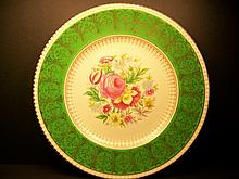 A beautiful gold and flower decorated plate. MEASURES 26.7cm DIAMETER