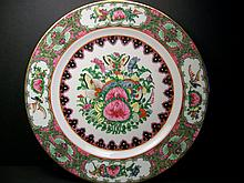 A beautiful and flower decorated plate.25.2cm DIAMETER