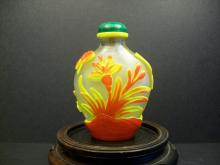 A RED AND YELLOW CHROMATOGRAPHY OUTLAID PEKING GLASS SNUFF BOTTLES