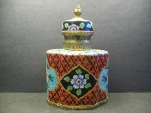 A finely and rare tea caddy with red enamel painted porcelain ground and western flowers and geometric designs