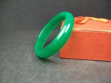 A finely green jade bracelet. 7.8x6.4x1.4cm, Weight:43g