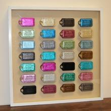 Lot of 28 COACH Bag Tags Framed in Shadowbox