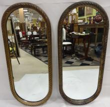 Pair of Gilt Modernist Oval Wall Mirrors