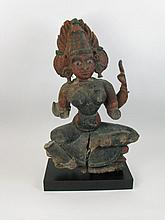 A WOODEN SCULPTURE OF A FEMALE HINDU DEITY,
