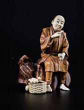 Okimono en forme de paysan fumant ivoire et bois