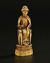 Figurine en forme de personnage assis ivoire,proba