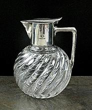 A Victorian silver mounted glass decanter in the