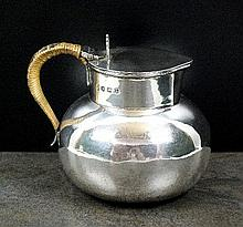 A silver cream jug with lid, William Hutton & Sons