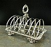 A William IV six division silver toast rack, WE,
