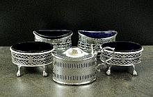 A pair of Edwardian navette shaped silver salts,