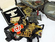 A box of assorted medals and badges etc, together