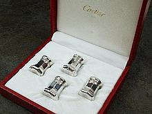 A cased set of four Cartier salt and pepper