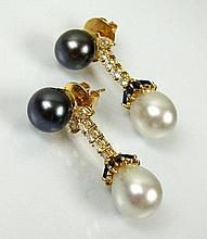 A pair of South Sea and Tahitian cultured pearl,