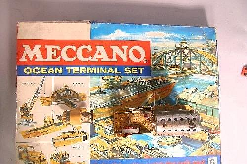 A Meccano ocean terminal set, catalogued No 6, dating from mid-1970s parts are in extremely good condition, box has torn edges, together with a Meccano parts set, airports service set catalogued No 4, also included is a box full of Meccano parts
