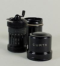 A Curta Type 1 calculator by Contina Ag Mauren