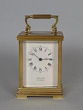 A 20th century brass carriage clock, the white