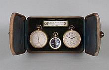 A cased timepiece barometer compass and