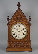 A late Victorian Gothic revival oak bracket clock,