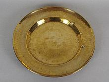 A George III brass alms dish with broad rim