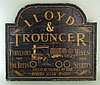 A painted wooden retailer's sign for 'Lloyd &