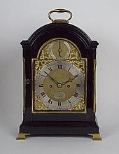 A George III ebonised eight day twin fusee bracket