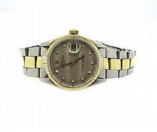Rolex Perpetual Date 14k Gold Steel Watch ref. 1505