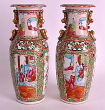 A PAIR OF 19TH CENTURY CHINESE CANTON FAMILLE ROSE VASES painted with birds and figures. 10.5ins high.