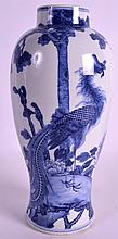 A MID 19TH CENTURY CHINESE BLUE AND WHITE VASE painted with a phoenix bird amongst foliage. 10.75ins high.