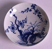A VERY RARE 18TH CENTURY WORCESTER MINIATURE SAUCER painted with prunus root. 2.75ins diameter.