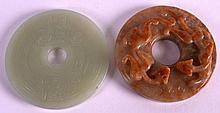 A CHINESE CARVED GREEN JADE BI DISC 20th Century, together with another mutton jade disc. Both 2.25ins diameter. (2)