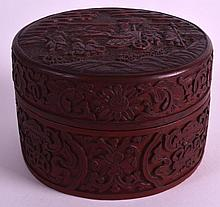 AN 18TH/19TH CENTURY CHINESE CINNABAR LACQUER BOX AND COVER decorated with figures kneeling before dignitaries. 4.75ins diameter.