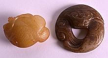 AN EARLY 20TH CENTURY CHINESE CARVED YELLOW JADE FIGURE OF A FISH together with a jade amulet. 1.5ins & 2ins wide. (2)