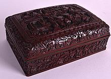 A 19TH CENTURY CHINESE CINNABAR LACQUER BOX AND COVER decorated with figures within landscapes. 6Ins wide.