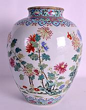 A GOOD CHINESE PORCELAIN FAMILLE ROSE BALUSTER JAR Daoguang mark and probably of the period, enamelled with flowering rock and fruiting pods. 10.75ins high.