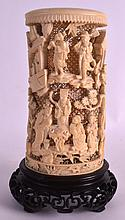 A GOOD MID 19TH CENTURY CHINESE CANTON IVORY BRUSH POT decorated with figures in various pursuits, seated under flowering vines. Ivory 8ins high.