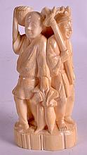 AN UNUSUAL LATE 19TH CENTURY JAPANESE MEIJI PERIOD IVORY OKIMONO carved all around with three figures. 4.75ins high.
