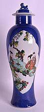 A MID 19TH CENTURY CHINESE POWDER BLUE GROUND VASE AND COVER painted with figures in the Kangxi style. 1Ft 2ins high.