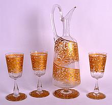 AN EARLY 20TH CENTURY BOHEMIAN GLASS DECANTER together with three glasses. Decanter 1ft 3ins high. (4)