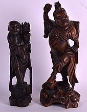 A 19TH CENTURY CHINESE CARVED HARDWOOD FIGURE together with another similar figure & soapstone brush pot. 13.5ins & 11ins high. (3)