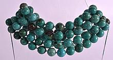 A GOOD EARLY 20TH CENTURY CARVED TURQUOISE NECKLACE of uniform size and varying colour tones. 4Ft 4ins long.