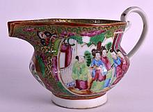 A 19TH CENTURY CHINESE CANTON FAMILLE ROSE JUG painted with figures within an interior. 7Ins wide.