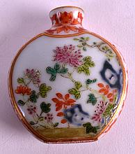A 19TH CENTURY CHINESE FAMILLE ROSE PORCELAIN SNUFF BOTTLE bearing Qianlong marks to base, enamelled with flowering rock and calligraphy. 2Ins wide.