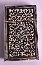 A LATE 19TH CENTURY ANGLO INDIAN CARD CASE AND COVER decorated with a figure. 2.25ins x 3.75ins.