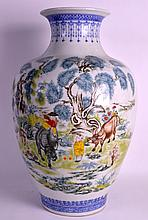 A VERY LARGE CHINESE PORCELAIN FAMILLE ROSE VASE 20th Century, decorated with boys and buffalo within landscapes. 1Ft 8.5ins high.