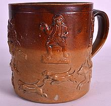 AN 18TH/19TH CENTURY ENGLISH STONEWARE TANKARD decorated with hunting scenes. 6.25ins high.