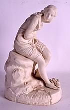 A 19TH CENTURY PARIANWARE FIGURE OF A FEMALE modelled clutching her chest upon a naturalistic base. 12Ins high.