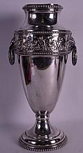 A 19TH CENTURY SILVER PLATED EUROPEAN VASE decorated in relief with figures within landscapes. 1Ft 3.5ins high.
