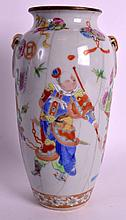 A MID 19TH CENTURY CHINESE CANTON FAMILLE ROSE VASE Daoguang, painted with figures and precious objects. 9.5ins high.